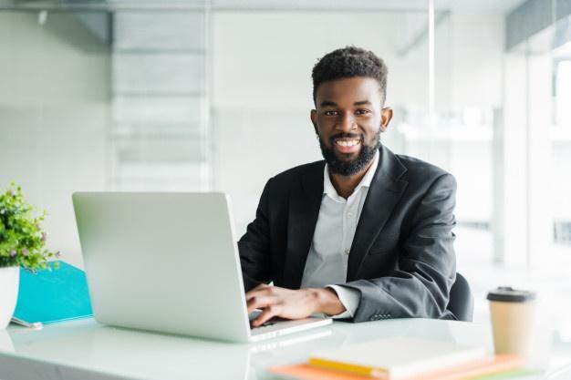 portrait handsome african black young business man working laptop office desk 231208 680